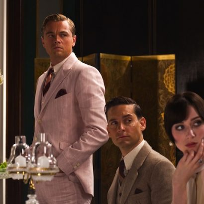 """(L-r) LEONARDO DiCAPRIO as Jay Gatsby, TOBEY MAGUIRE as Nick Carraway and ELIZABETH DEBICKI as Jordan Baker in Warner Bros. Pictures' and Village Roadshow Pictures' drama """"THE GREAT GATSBY,"""" a Warner Bros. Pictures release."""